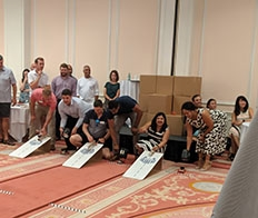 ScottMadden's annual meeting included a team building activity with solar car builds and races.