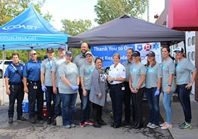 Coast employees volunteering at the company's First Responders Day Cookout.