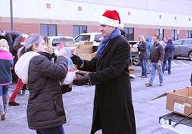 Coast CEO, Brian Davis, hands out a Christmas turkey.