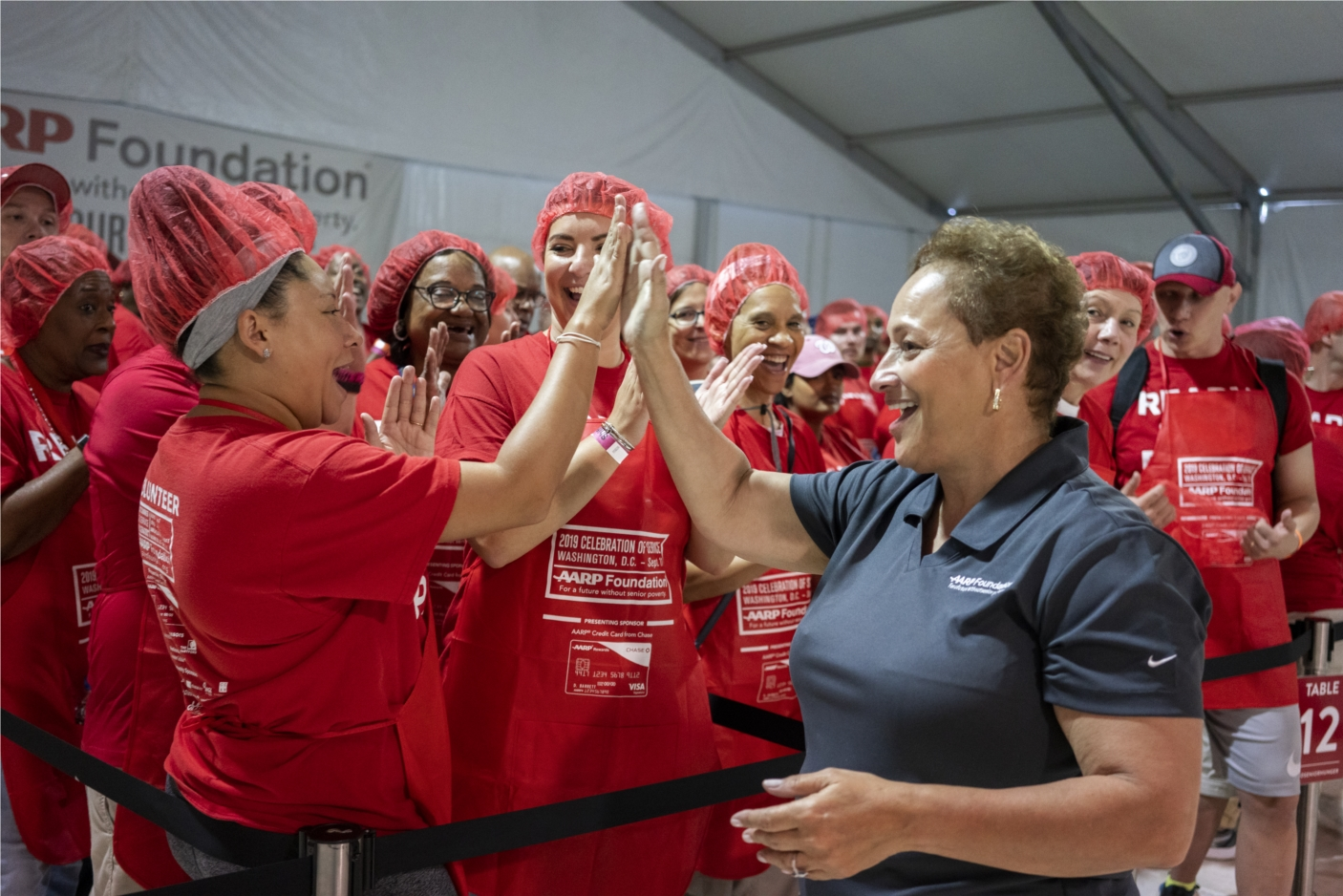 AARP CEO Jo Ann Jenkins and staff members volunteer at AARP Foundation's annual Celebration of Service Meal Pack Challenge on the National Mall