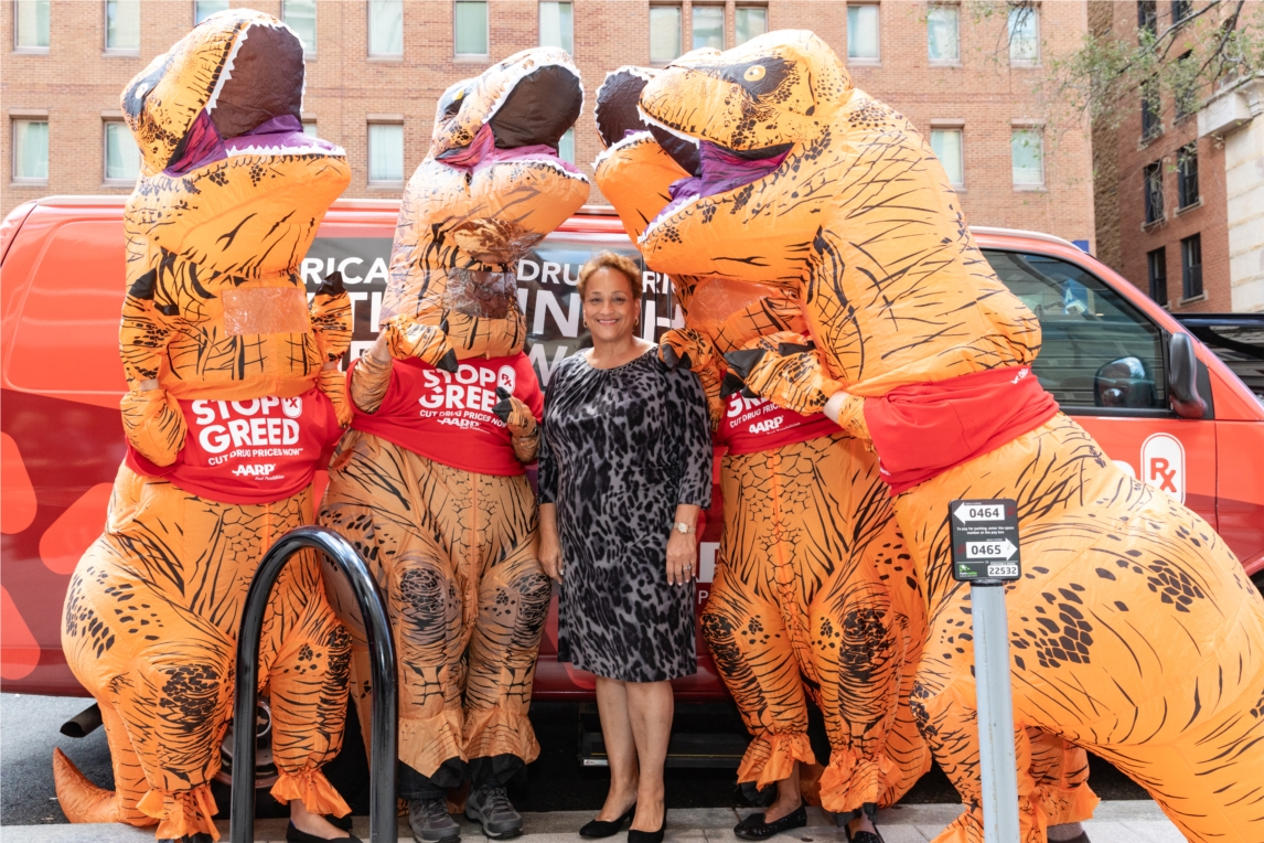 AARP Rx T-Rexes and CEO Jo Ann Jenkins advocating to lower prescription drug prices as part of the Stop Rx Greed campaign