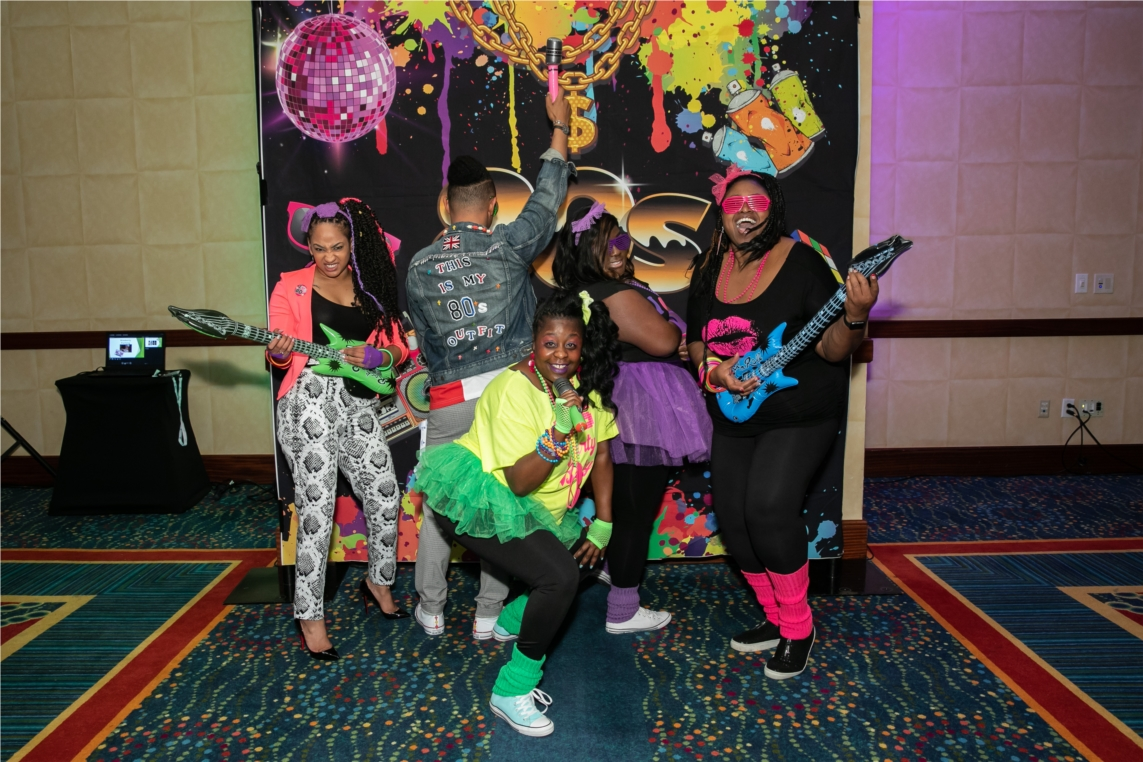Atrium Hospitality Associates showing off their 1980's best at the kick-off party for the 2019 Annual Human Resources & Accounting Leaders Conference