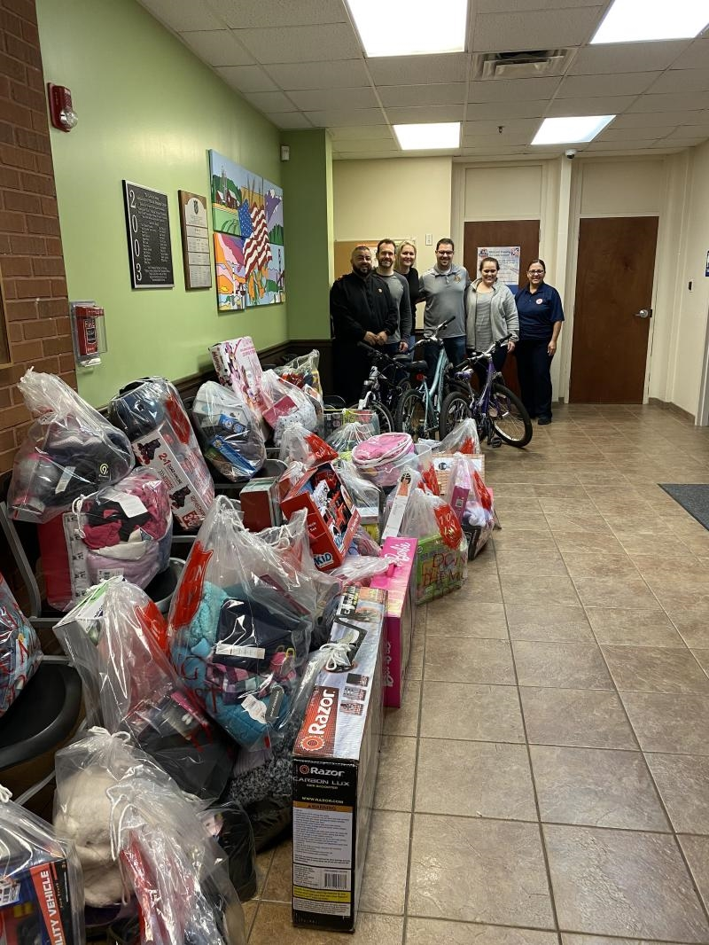 """Our Corporate Office and ATL Service Center adopted 35 """"angels"""" through The Salvation Army's Angel Tree program. This program enables children and families living under the poverty line to have an enjoyable holiday by donating clothes and toys."""