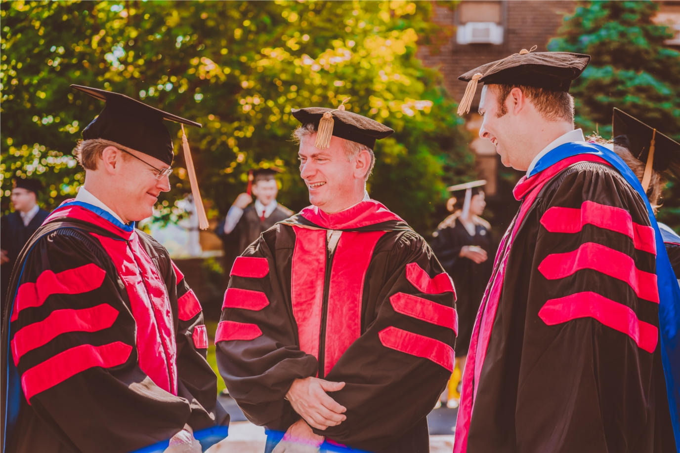 Three Ministerial Education Division faculty members talk prior to commencement