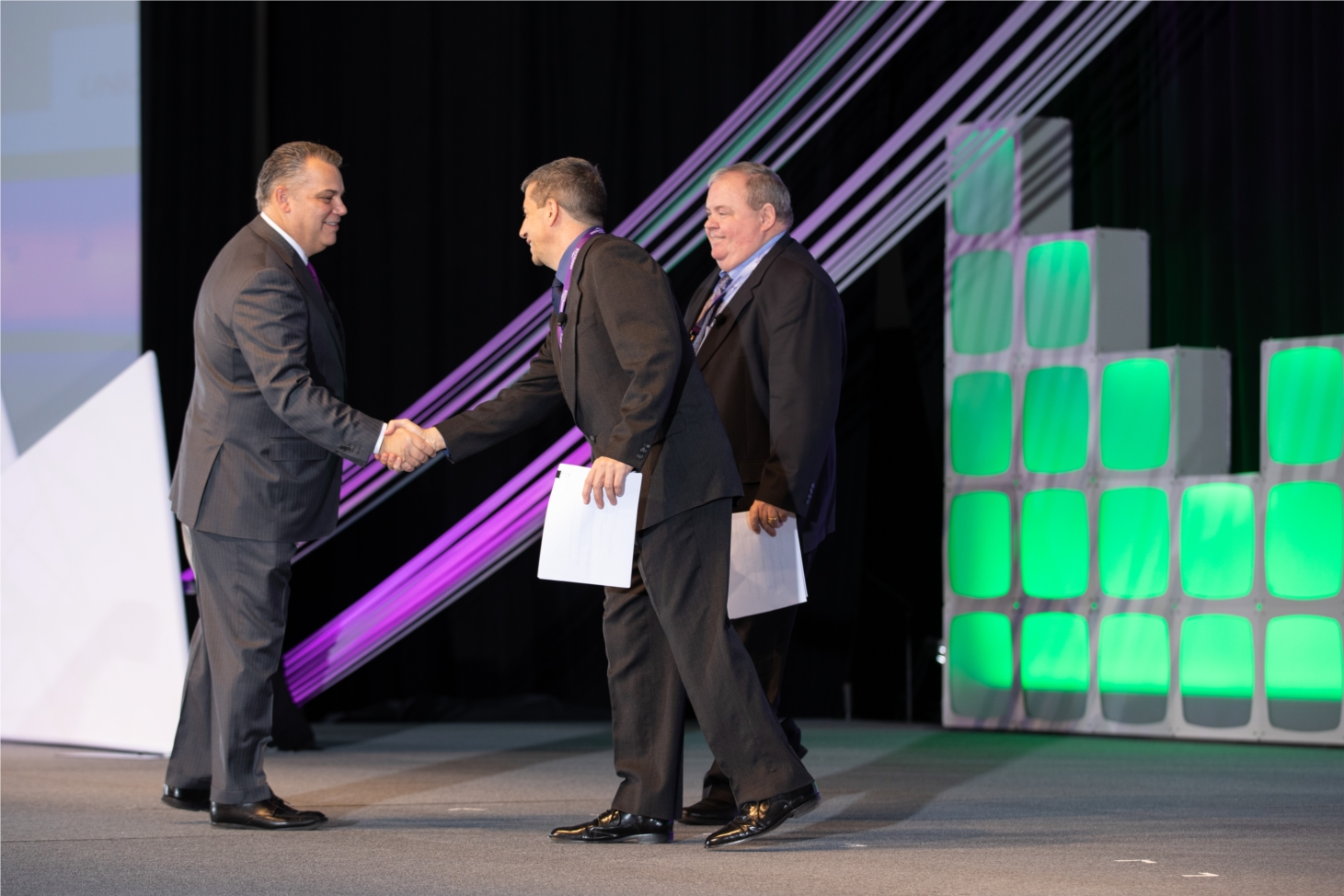 CEO and Owner, Bill Cosgrove, welcomes National Sales Manager, Mike Jones, and SVP of Retail Sales, Jim Ferriter, to the stage at the 2019 Annual Partner Celebration.