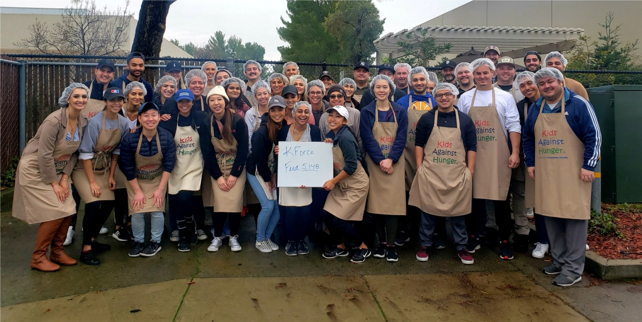 Kforce gives back to the local community on its annual Day of Giving. This team spent their work day packaging meals for the Kids Against Hunger organization.