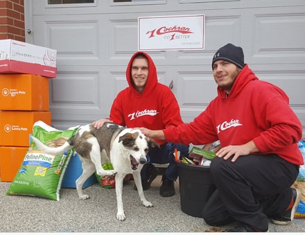 Team Members dropping off food to the local Animal Shelter for Share the Love Event.
