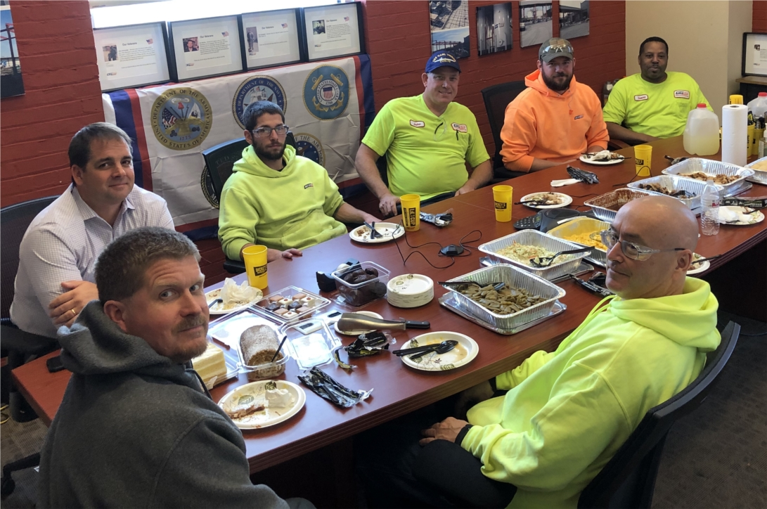 KOST team members sharing a meal and stories on Veterans Day.