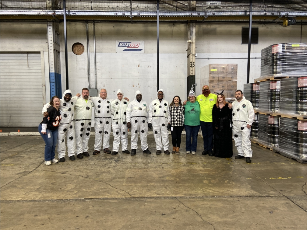 KOST team members showing off their best costumes for Halloween.