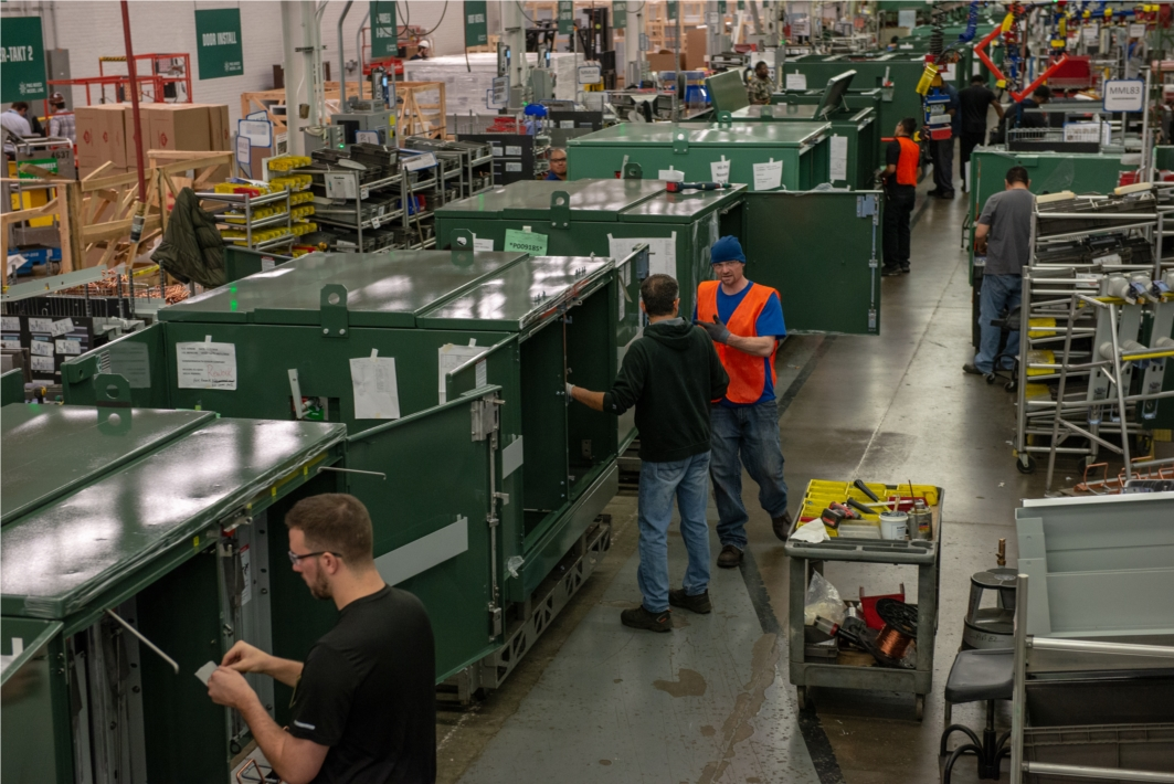 S&C team members assembling switchgear. *Photo taken prior to COVID-19 and related safety guidelines.