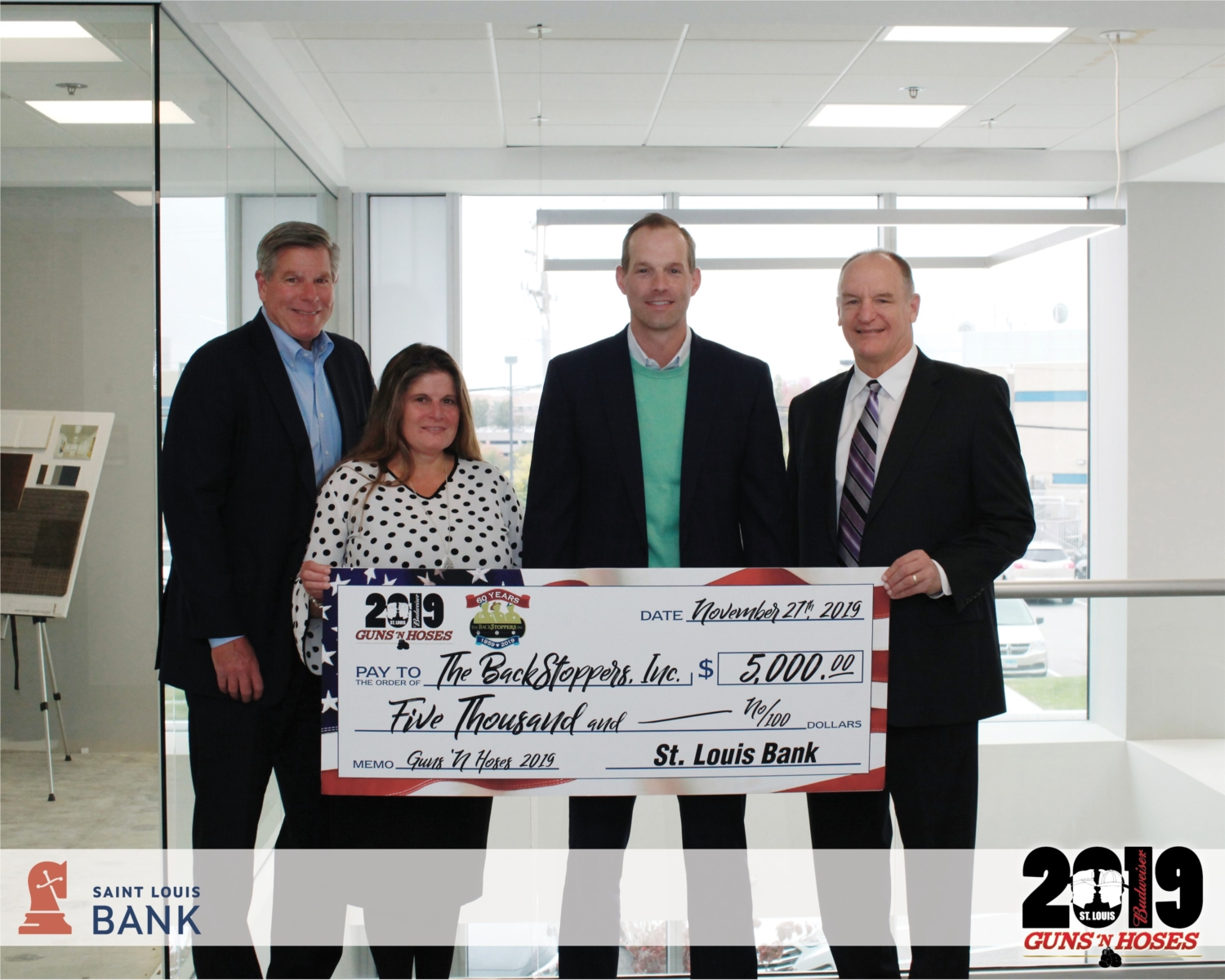 Saint Louis Bank donates $5,000 to The BackStoppers Inc. 2019 Guns 'N Hoses event.  Saint Louis Bank champions this community. Being involved in an organization that profoundly supports the first responders and their families, perfectly aligns with our core values. We are inspired by these heroes (both men and women) and the sacrifices they make daily.  Investing in our community drives Saint Louis Bank, which unites our team members and our family and friends.