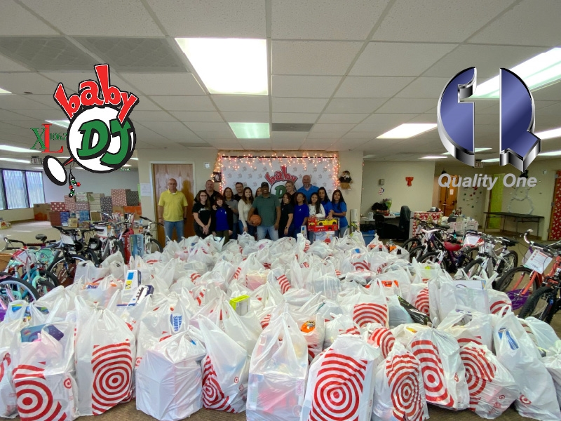 "Employees at Quality One value giving back to the community in a variety of ways.  Here, we partnered with ""Johnny Magic,"" the host of the top-rated morning radio show in Central Florida, and his Baby DJ Christmas Fund & Toy Warehouse program to allow area children from economically disadvantaged families to retain the magic of Christmas."