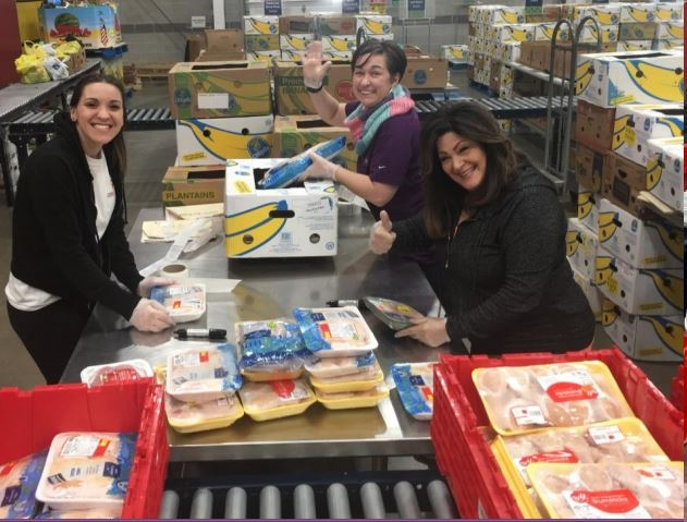 FoodShare – 3.9.19  A few of the many volunteers that helped a local food bank, FoodShare, to unbox and shelf over 6,700 packages of meat to combat food insecurity for families in Hartford.