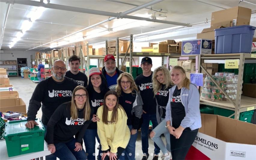 Lou Malnati's team members volunteer at Crystal Lake Food Pantry in support of Kindness Rocks, Lou Malnati's charitable giving program