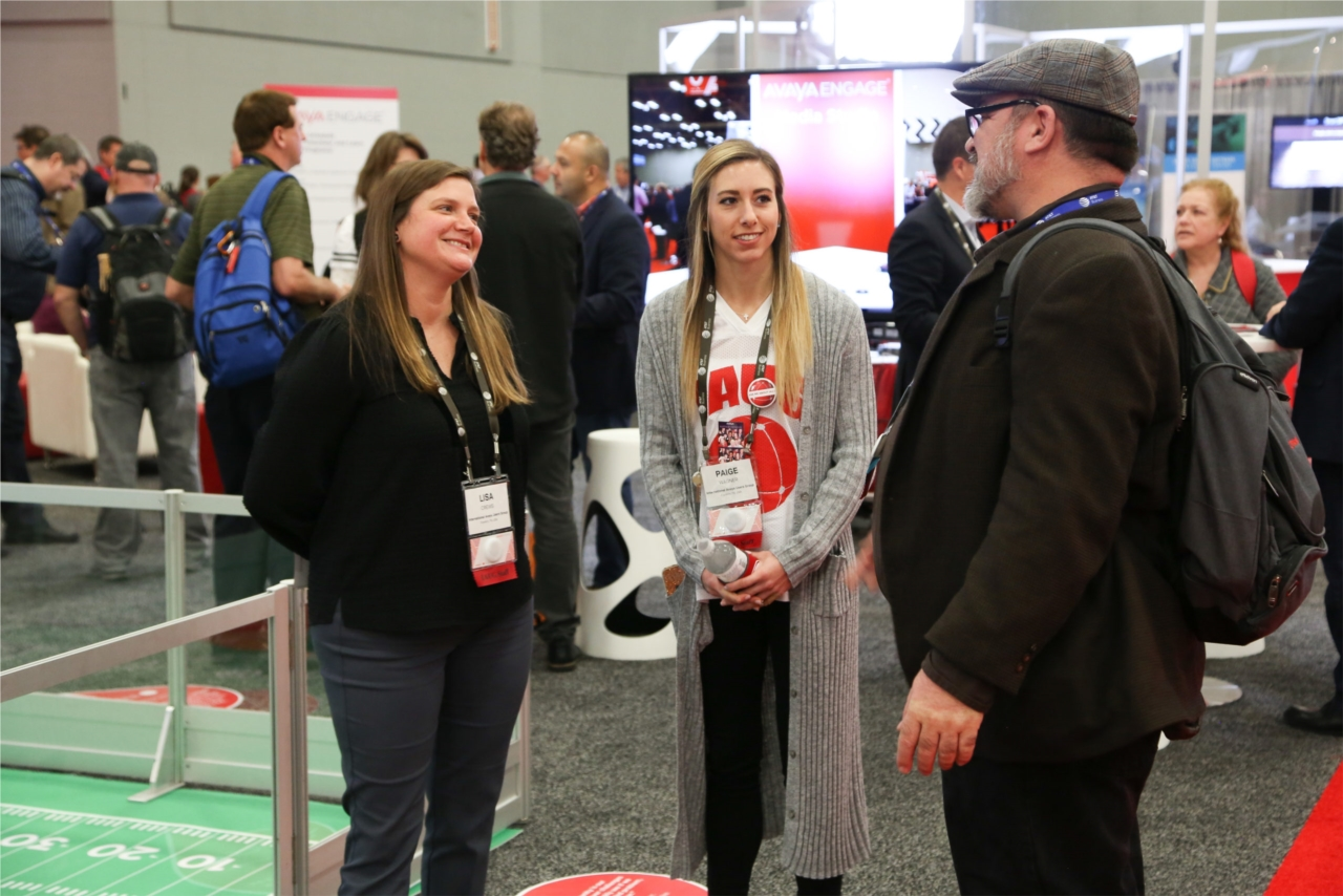 Lisa Crews from our Sales Team and Paige Romanello from our Events Team talk to a member during our client's national conference.