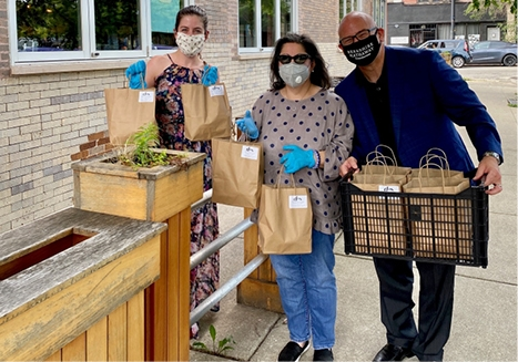 Rachel Kane, Anne Rodia and David Bracy of the Berkshire Hathaway HomeServices Chicago Michigan Avenue office thank Mercy Hospital staff with Taco Tuesday.