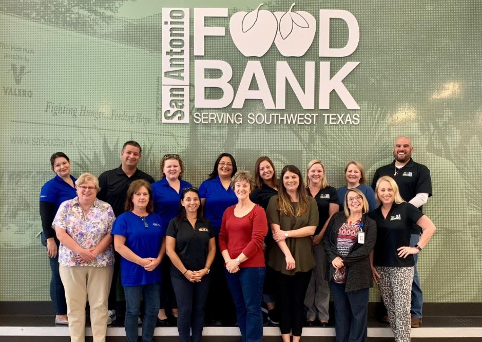 Giving back to the local community through our volunteer work days at the San Antonio Food Bank.