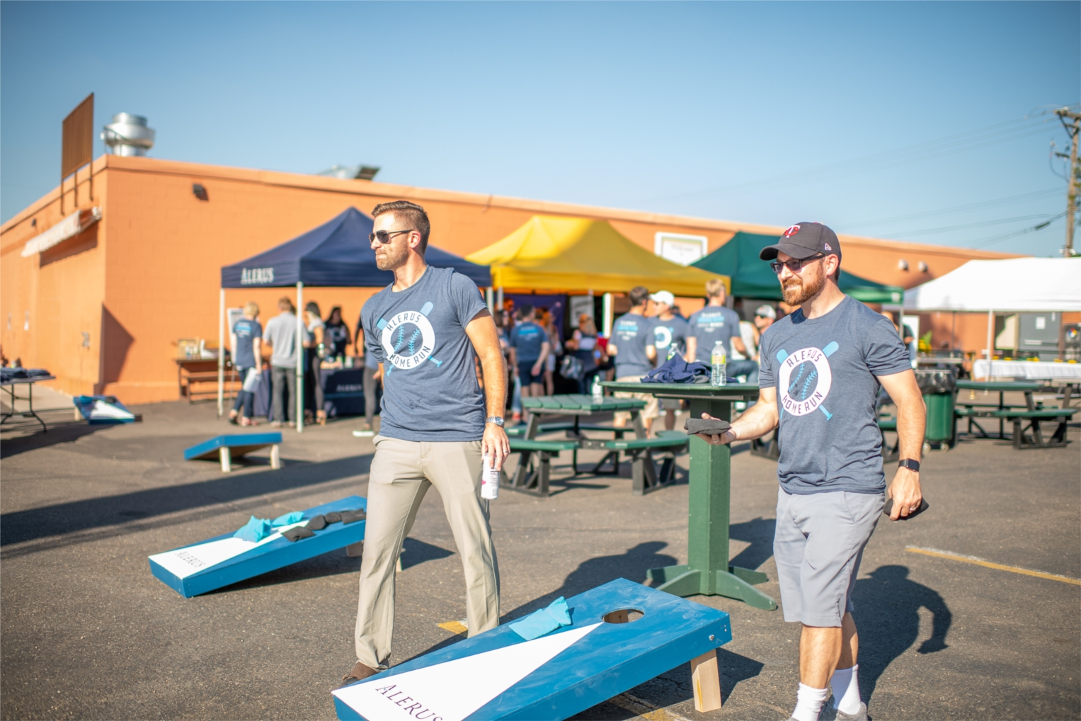 Alerus employees hosting guests during a tailgating-style event.