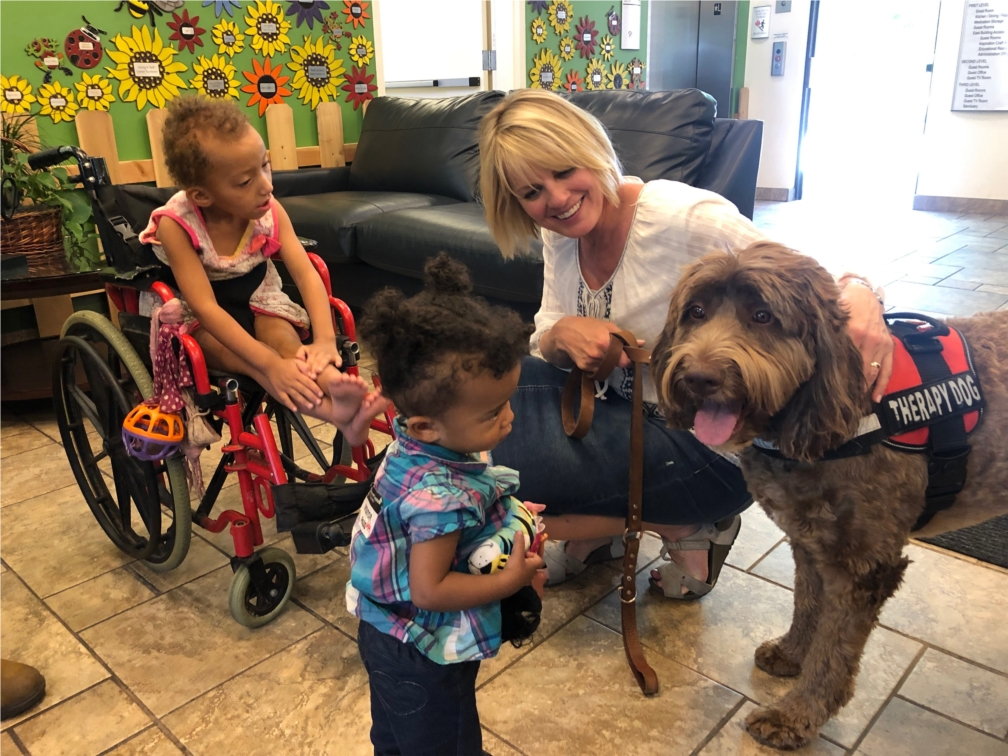 Chief PAWSitivity Officer, Ollie, and RMHC guests