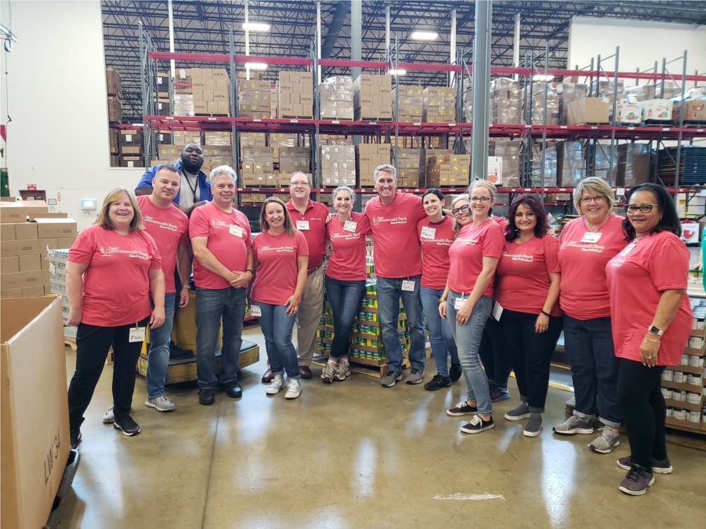 Participants from the First Commonwealth Mentorship Program volunteer at the Greater Pittsburgh Community Food Bank.