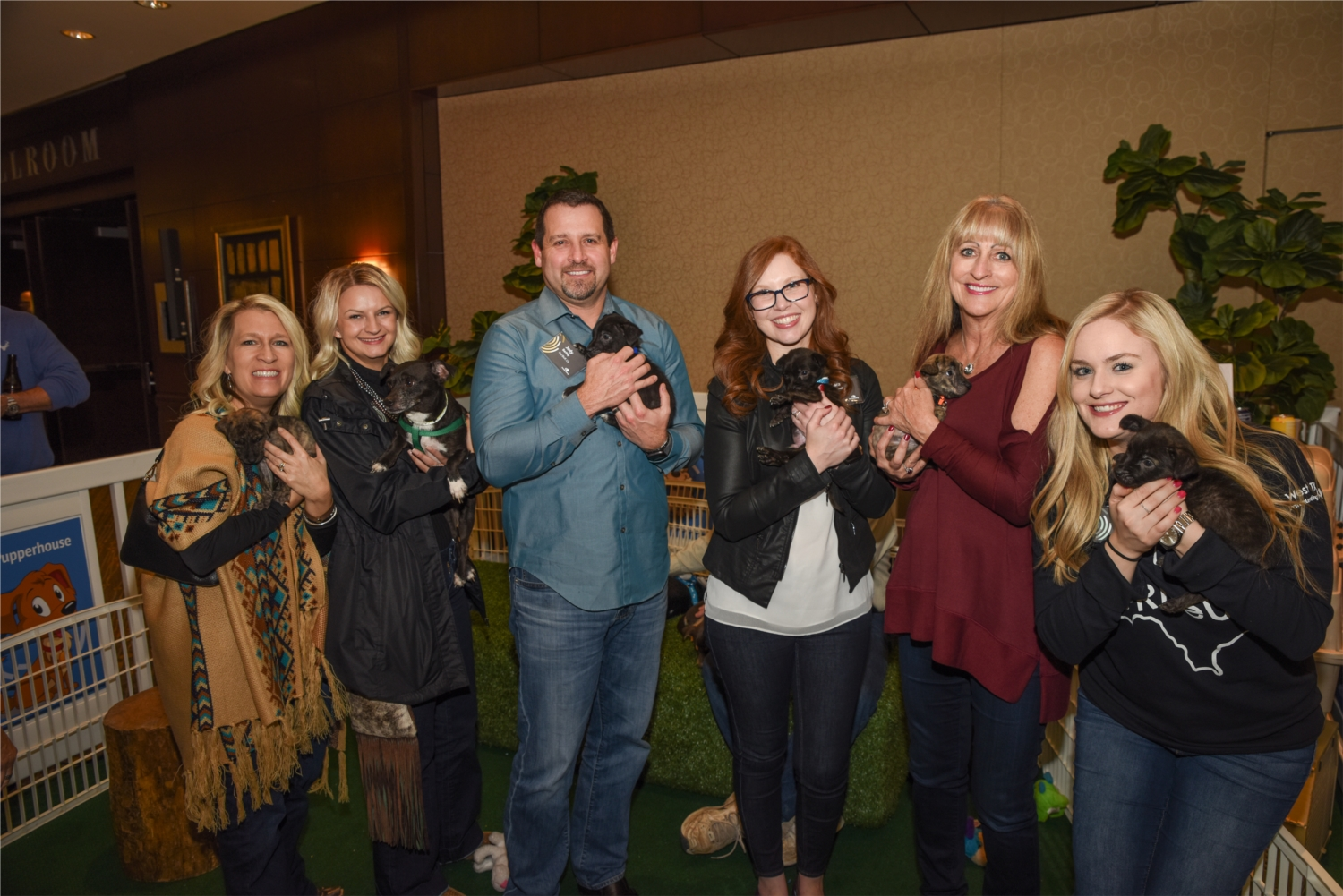 Attendees at our Annual Sales Rally snuggling with puppies up for adoption from local DFW dog rescues!