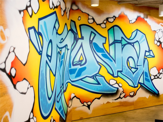 Enova's graffiti walls were created by a local artist and provide an energetic backdrop for team members looking to collaborate away from their desks.