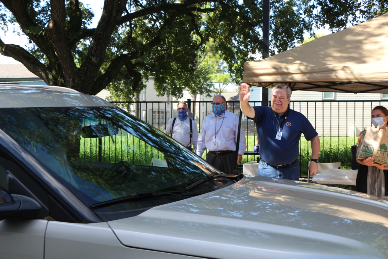 Department members stage a drive-by retirement celebration during the pandemic.
