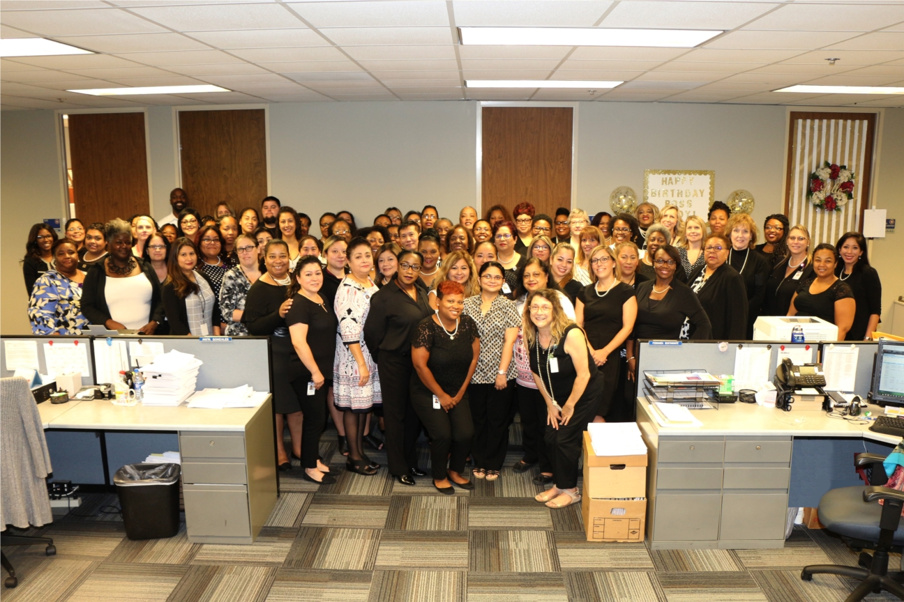 Members of the Information and Assistance Division gather for a photo while celebrating their accomplishments.