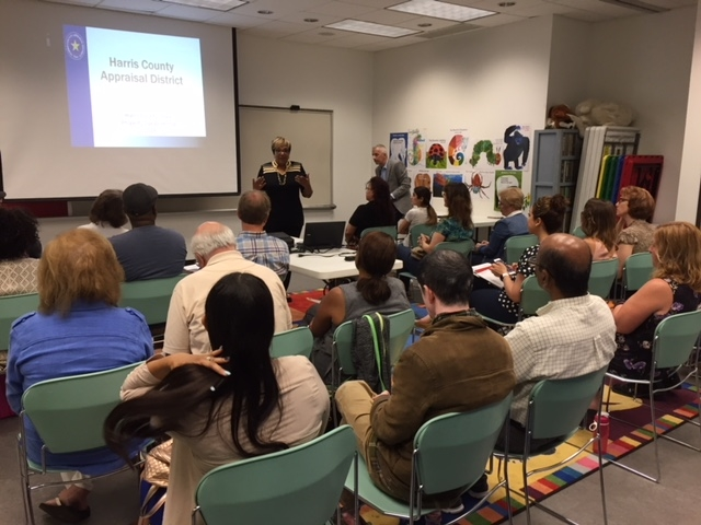 District employees explain the appraisal process to property owners at a public meeting.