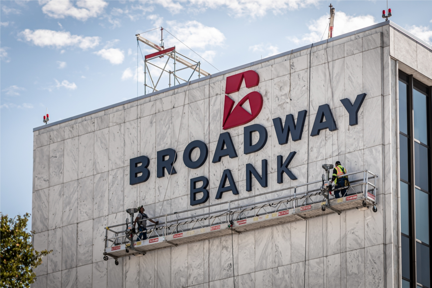 Crews install Broadway Bank's new logo at the Main Financial Center at 1177 N.E. Loop 410 in August.