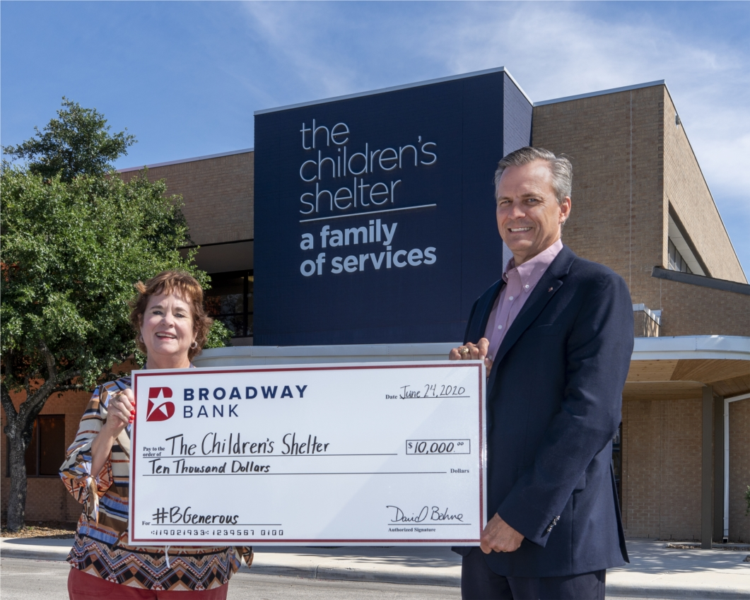 Broadway Bank CEO David Bohne presents a $10,000 check to The Children's Shelter as part of the #BGenerous donation campaign in May.  Broadway Bank helped raise a total of $35,000 in COVID-19 relief funds for the shelter.