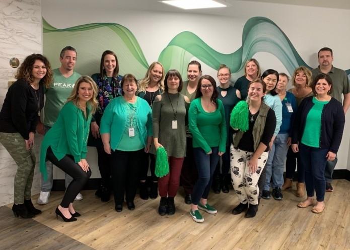 MTM staff members wear green in support of International Women's Day 2019.