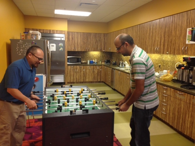 Competition and relaxation in our kitchen and game room.